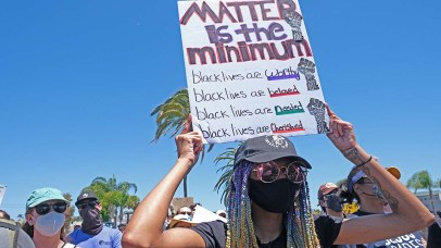 Protest organizers demanded at the La Mesa Police Department release the name of the officer who shot protester Shirley Furchron in the head at a previous demonstration.