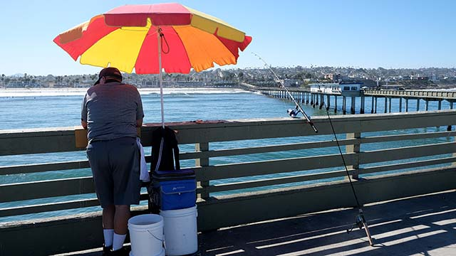 A fisherman takes advantage of the opening of the Ocean Beach Pier on June 9.