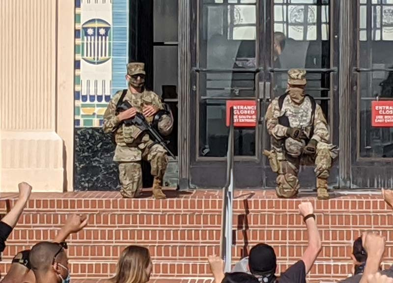 National Guardsmen watch protesters from western entrance of County Administration Center.