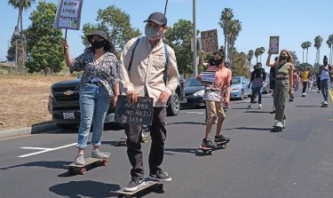 Young protestors rode north of Mission Bay Drive nearly the length of the park to protest for racial equality.