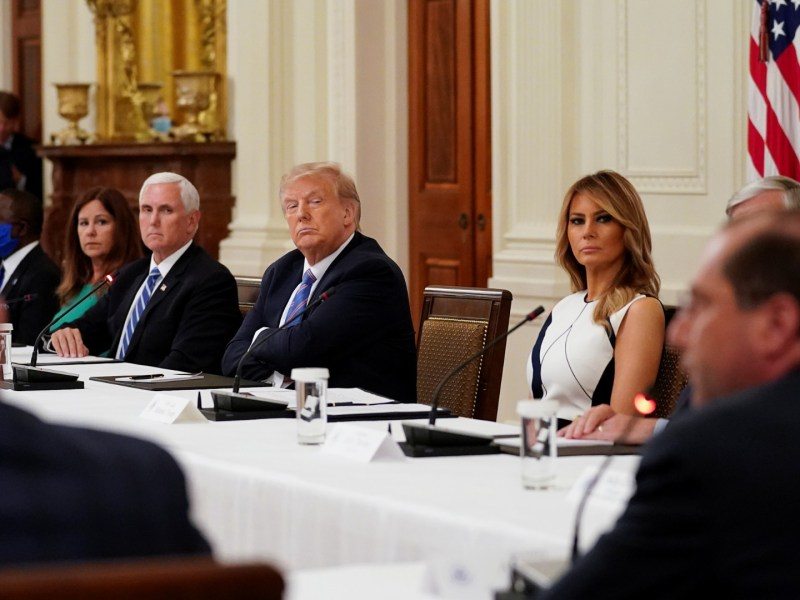 The President listens during a meeting