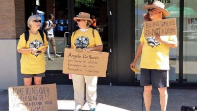 Wearing All-Star Game parody T-shirts, activists held signs to note the homeless crisis during the July 2016 All-Star Game at Petco Park.