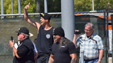 Roger Ogden, seen at Aug. 1 protest in La Mesa, often videotapes protests from the counterprotester side.