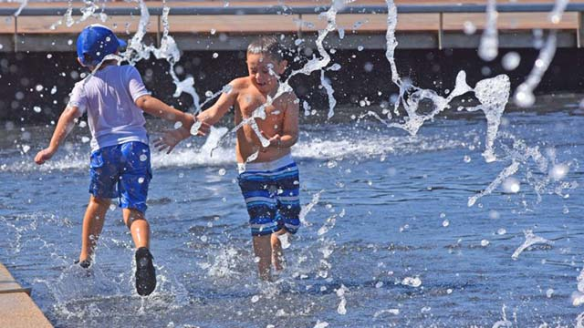 Children splash in Waterfront Park near the San Diego County Administration Building downtown.