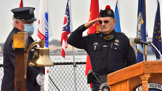A ceremonial bell is rung at 9/11 memorial on the USS Midway Museum.