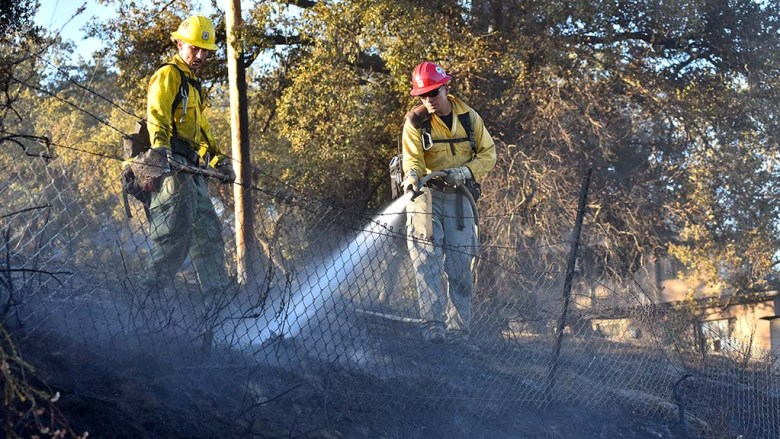 Two hours after the fire was reported around 4 p.m., mopping up activity continued.