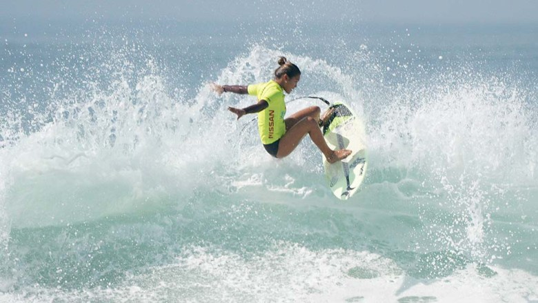 Surfer Vahiti Inso from Hawaii competes alongside Qualifying Series (QS) teammates in the quarterfinals of the Nissan Super Girl Surf Pro.
