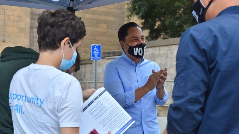 Assemblyman Todd Gloria reacts to a comment made by a campaign worker in Mission Valley.