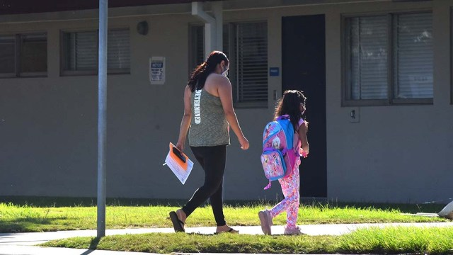 Children went back to the classroom in San Diego Unified School District as part of Phase 1 to help special needs students. The girl is returning to Lafayette Elementary School in Clairemont.