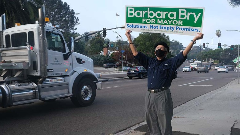Neil Senturia, husband of San Diego City Councilwoman Barbara Bry, leads the early morning campaigning in La Jolla.