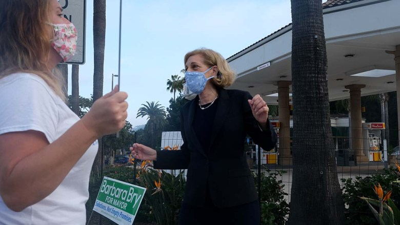 """Mayoral candidate Barbara Bry dances to """"I'm Still Standing"""" by Elton John in early morning campaigning in La Jolla."""