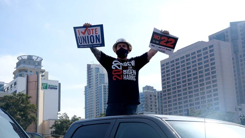 A union member shows his support of Democratic candidates at a car rally downtown on Election Day.