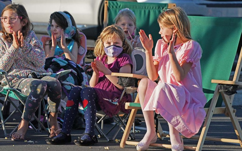 """Children applaud a section of the """"Nutcracker"""" performance as the San Diego Ballet's """"Nutcracker"""" moves outdoors because of the pandemic."""