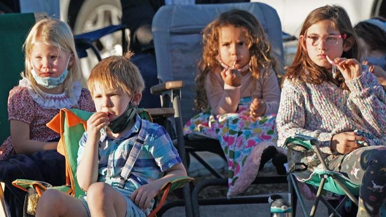 "Children watch an outdoor performance of San Diego Ballet's ""Nutcracker"" at Liberty Station."