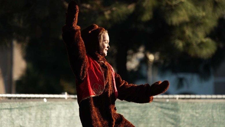 """A student of the San Diego Ballet School plays a Russian Gummy Bear in a drive-in performance of """"Nutcracker"""" at Liberty Station."""
