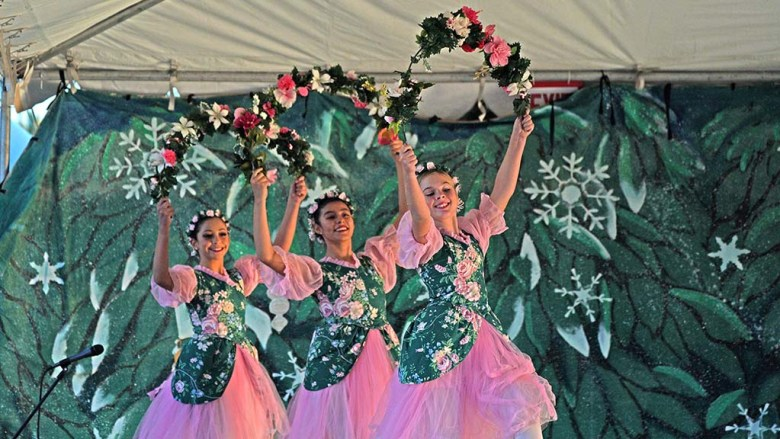 """Students of the San Diego Ballet School dance as Garland Girls in an outdoor performance of """"Nutcracker"""" at Liberty Station."""