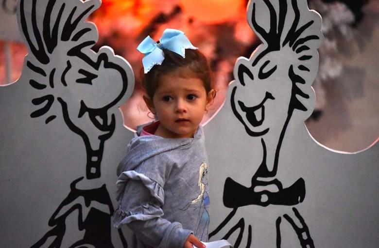 Josephine, 2, daughter of Joe Denesowicz of Joe's Barber Shop in El Cajon, visits the Whos.