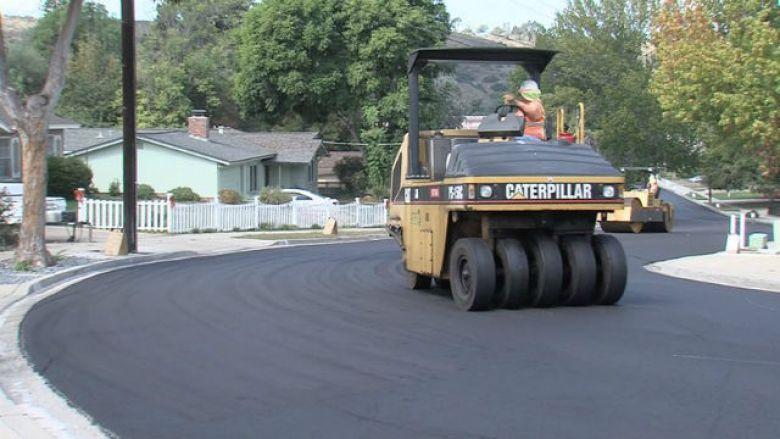 City crews repaving a street