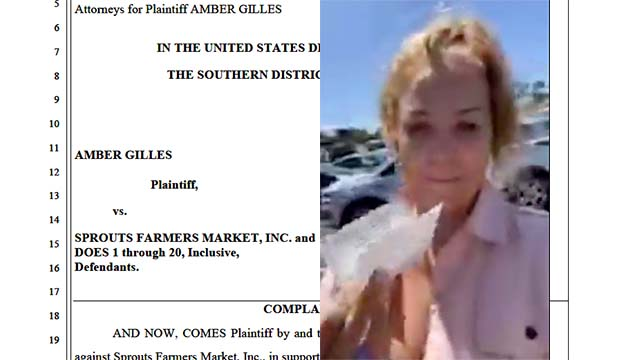 """Amber Gilles displays what she calls her """"medical exemption"""" allowing her to enter Sprouts without a face mask."""