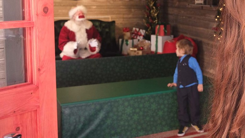 Boy looks to Santa at Mission Valley Mall the day after Thanksgiving.