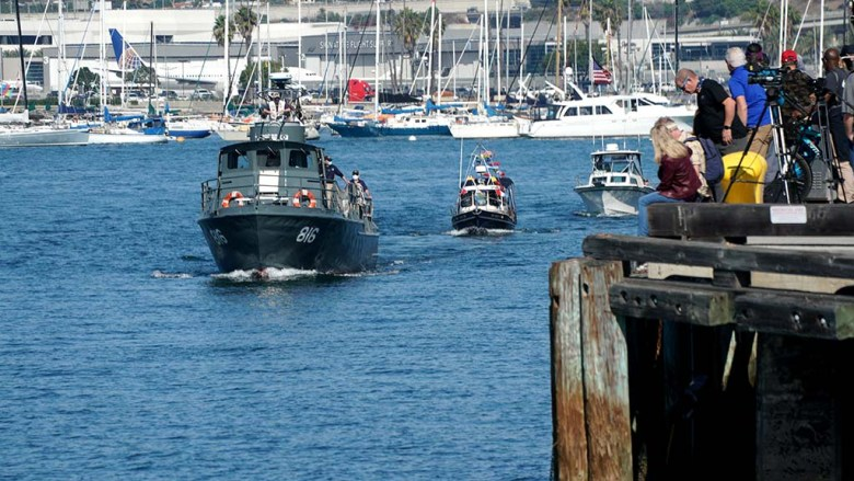 A PCF 816 swift boat lead a parade with dozens of private boats that started at Point Loma, going down to the Coronado Bridge and back.