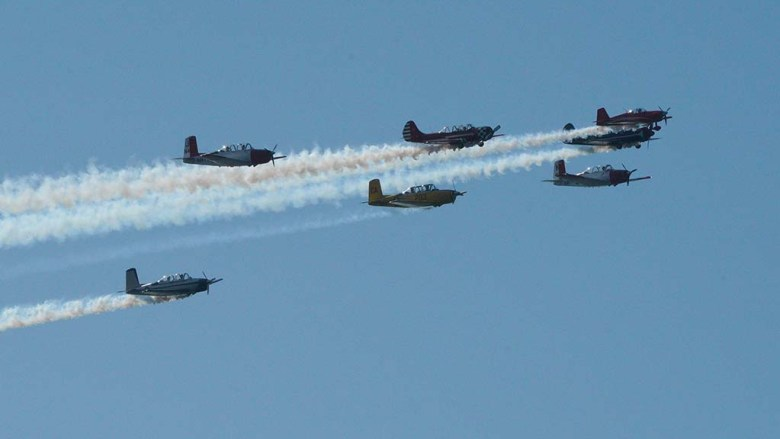 Vintage aircraft conducted a flyover in San Diego Bay during Veteran Day events.
