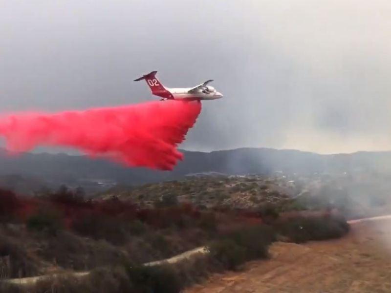 Fire tanker drops retardant