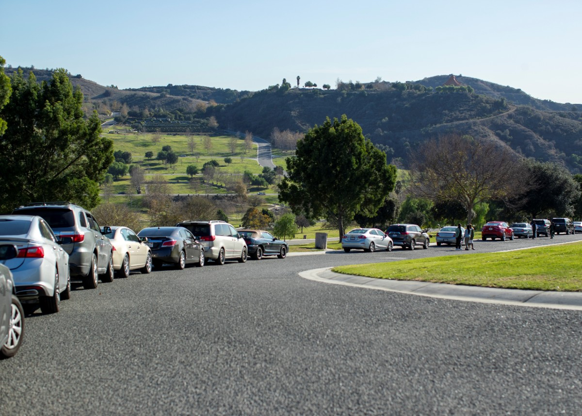 Cars link up for burials at Rose Hill Memorial Park