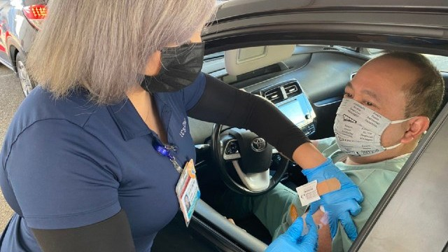 Man vaccinated in his car