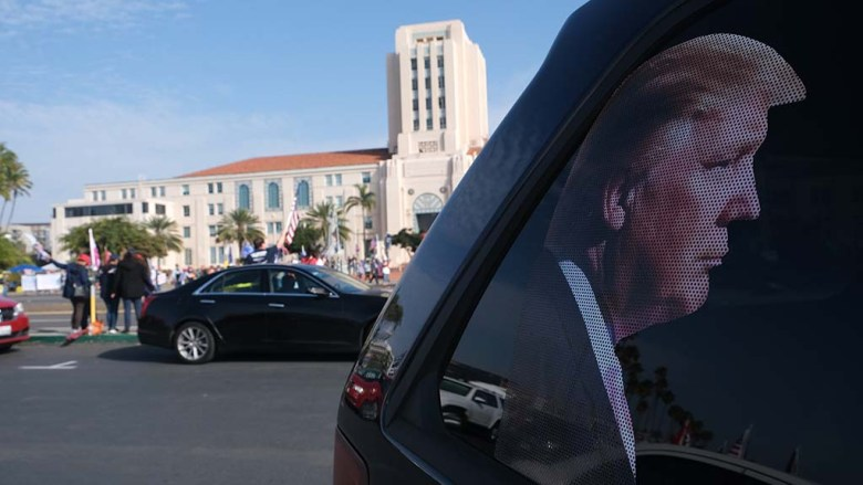 A Trump supporter's car across the street from the San Diego County Administration Building has a backseat photo of the president.