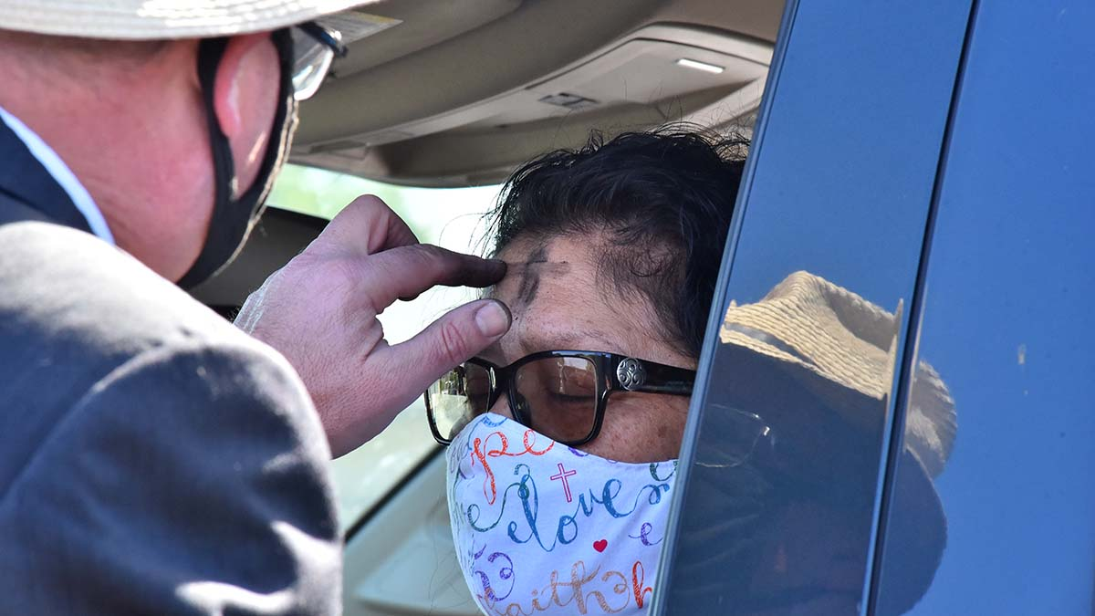 Angela Villa of San Diego receives ashes from the Rev. Jonathan Doolittle at Clairemont Luth