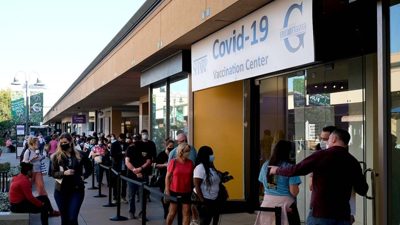 People with appointments line up at the Sharp Covid-19 vaccination supersite at Grossmont Center in La Mesa.
