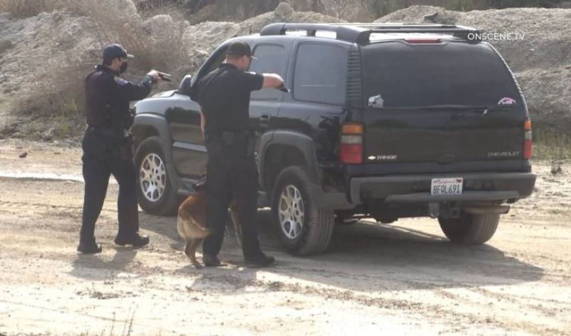 Officers approach abandoned Chevy Tahoe