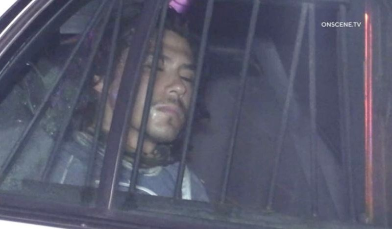 Suspect in stabbing detained in police cruiser