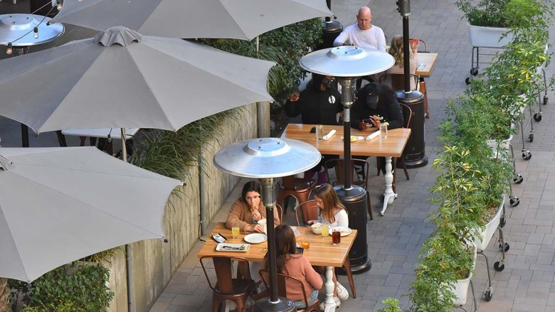 Heat lamps are arrayed at Fashion Valley outdoor dining area on Fashion Valley on Feb. 6, 2021.