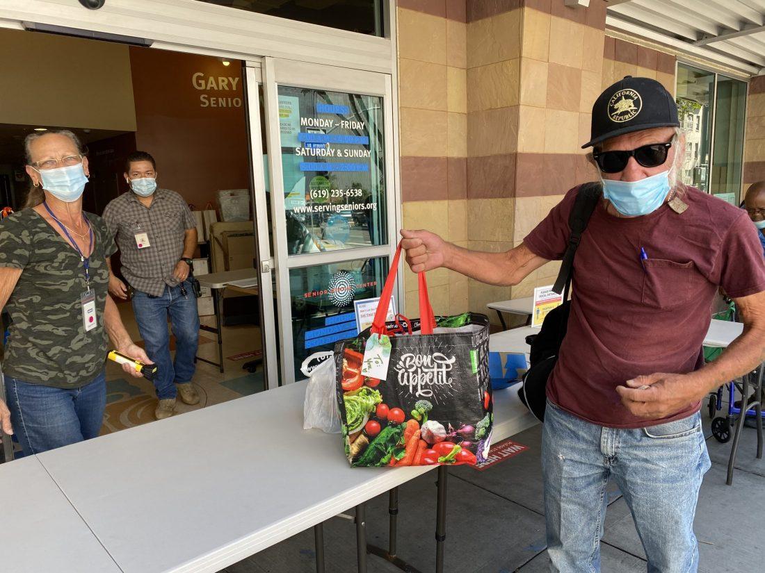 A senior receives food