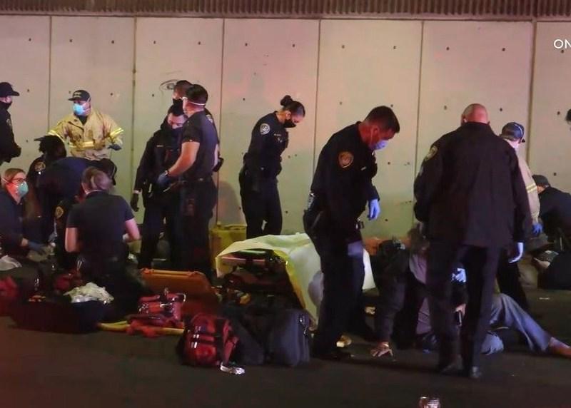 Police and paramedics assist victims