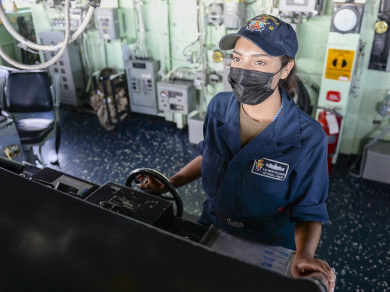 Navy Seaman Rose Ramirez steers a guided-missile destroyer