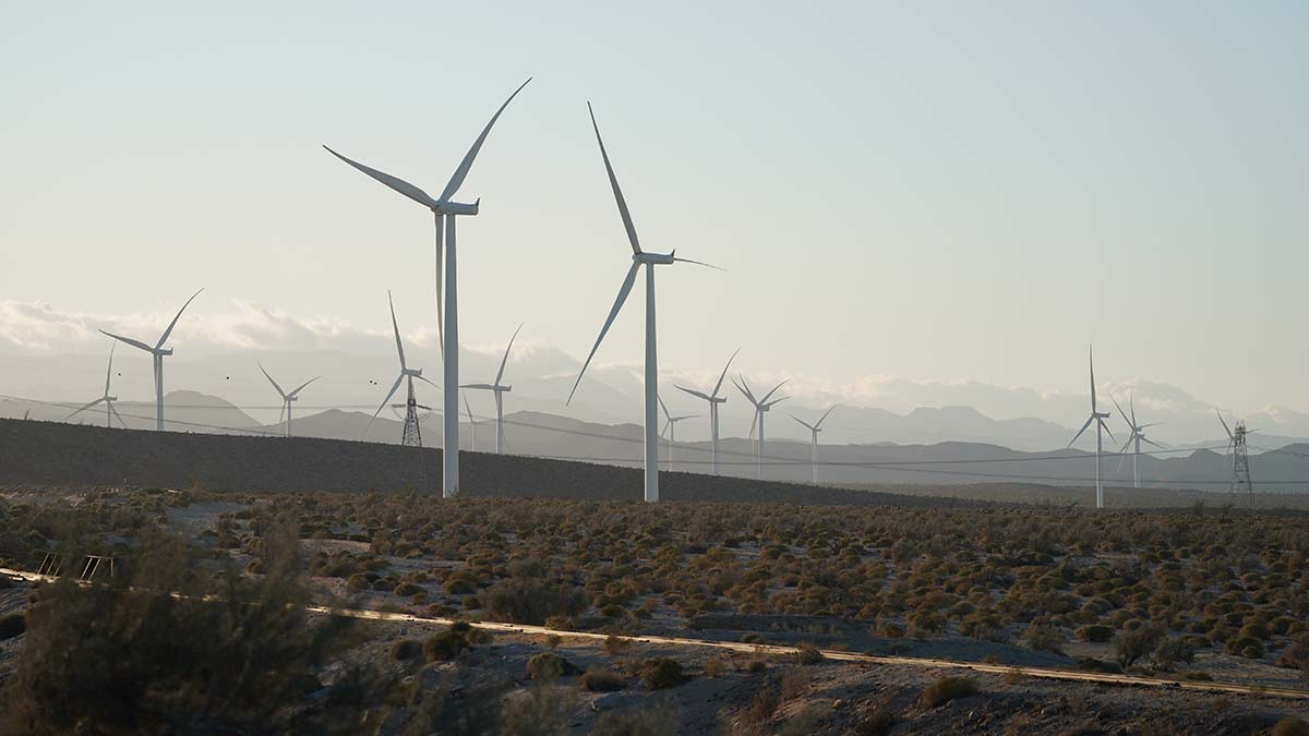 Wind turbines spin at the