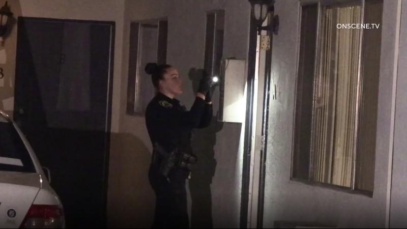 Police officer photographs crime scene