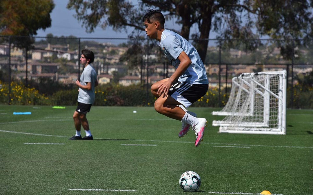 Ian Mai takes a warmup jump during practice at the Chula Vista Elite Athlete Training Center. Photo by Chris Stone