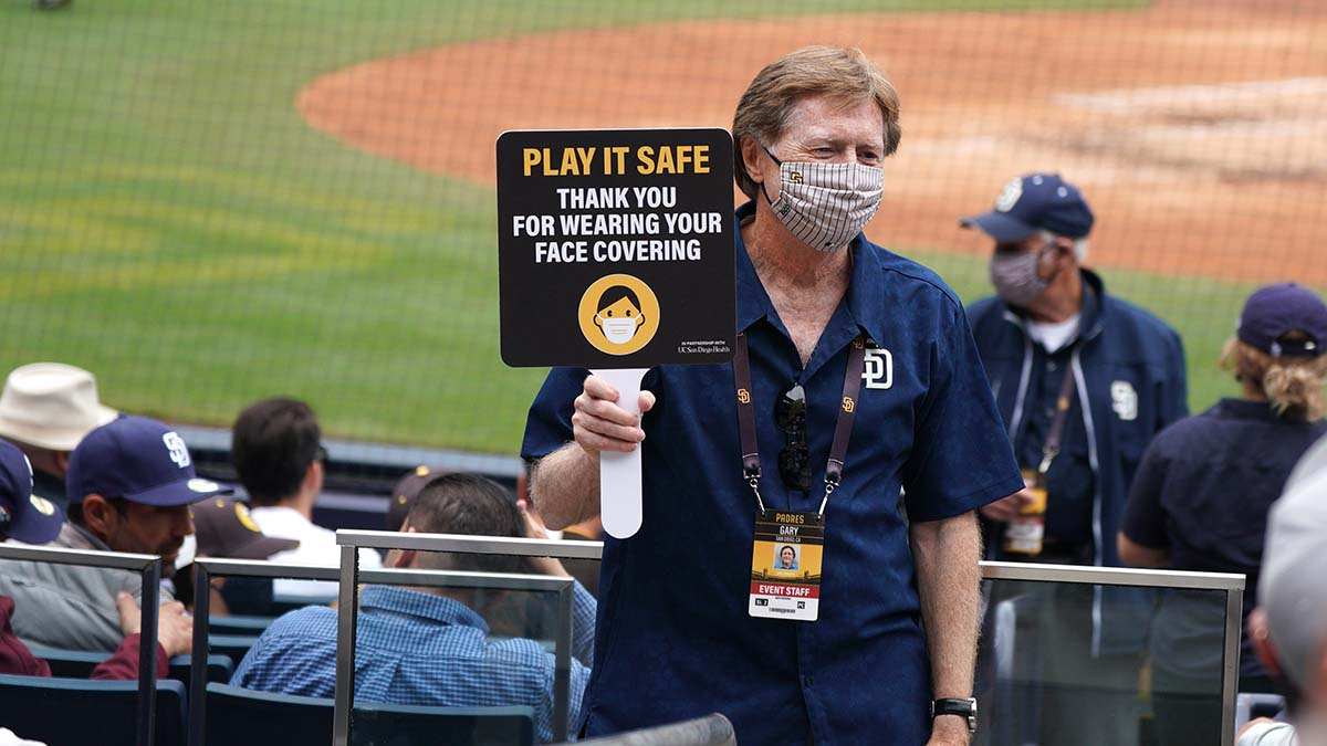 Ushers encouraged fans to wear masks, but many ignored the message.