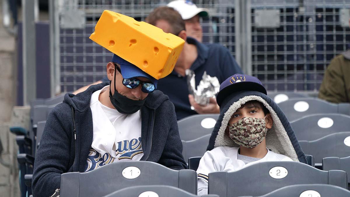 A Milwaukee Brewer fan wears a cheese head. Photo by Chris Stone
