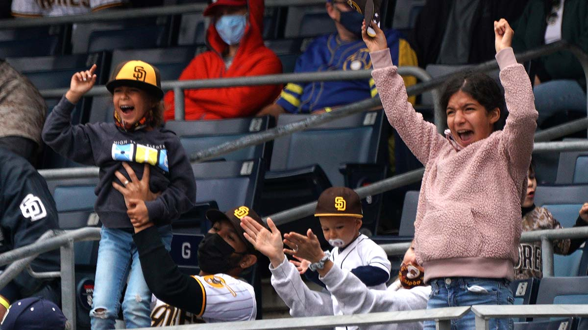 Young fans cheer as the bases are loaded.