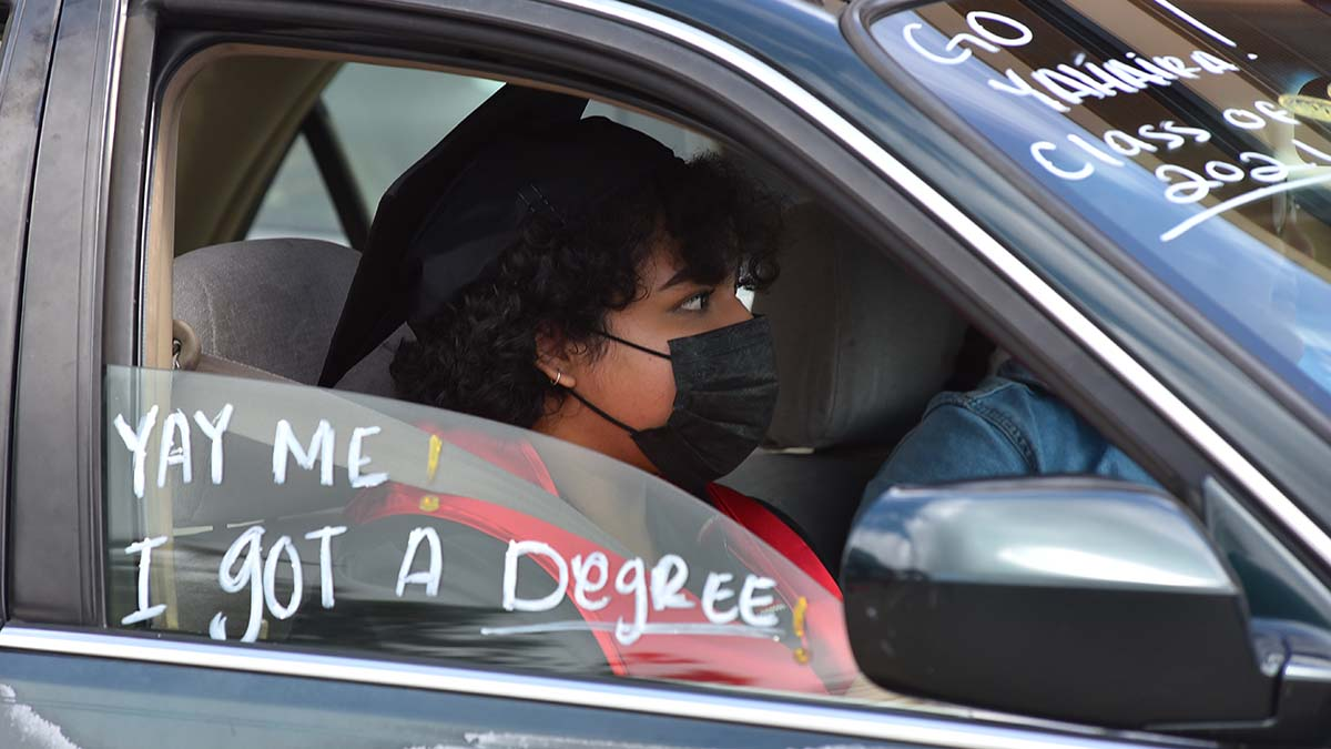 Writing on car windshields and windows express the students accomplishments. Photo by Chris Stone