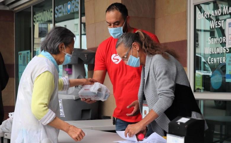 Cody Martinez distributing food