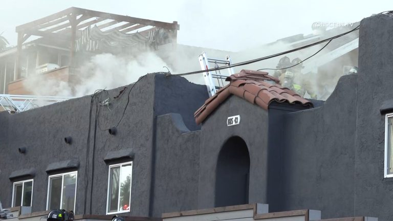 Smoke from burning apartments