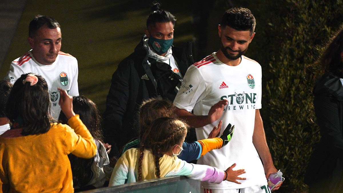 Loyal players are greeted by young fans. Photo by Chris Stone