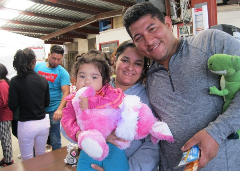 Migrant family with stuffed animal