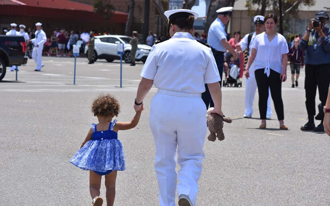 A crew member heads home with her daughter. Photo by Chris Stone